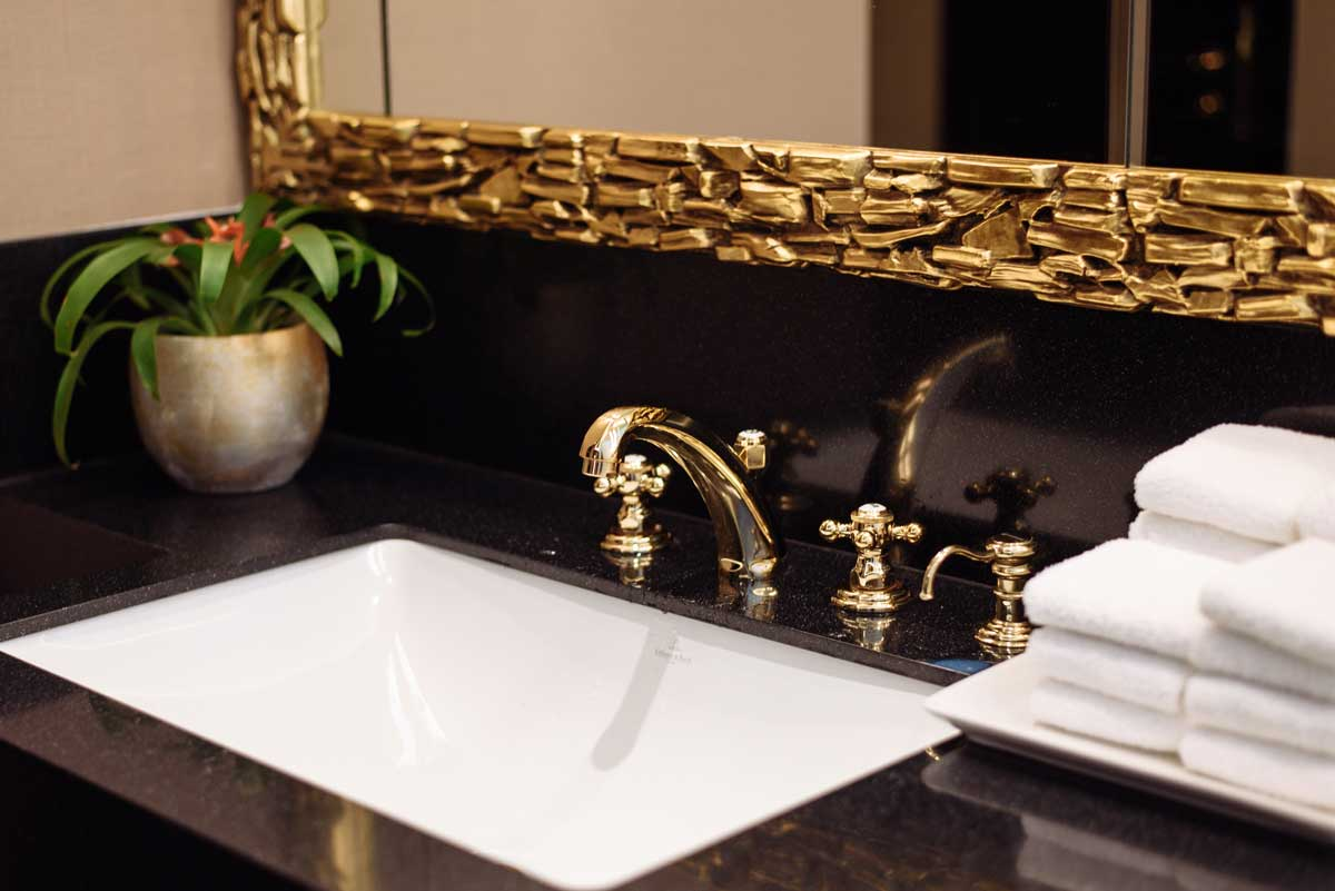 gold accents add drama and flair to any bathroom